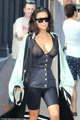 Kim Kardashian flaunts her nippl3s in sheer bustier